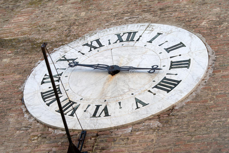 Siena, Italy. Old clock on the wall royalty free stock image