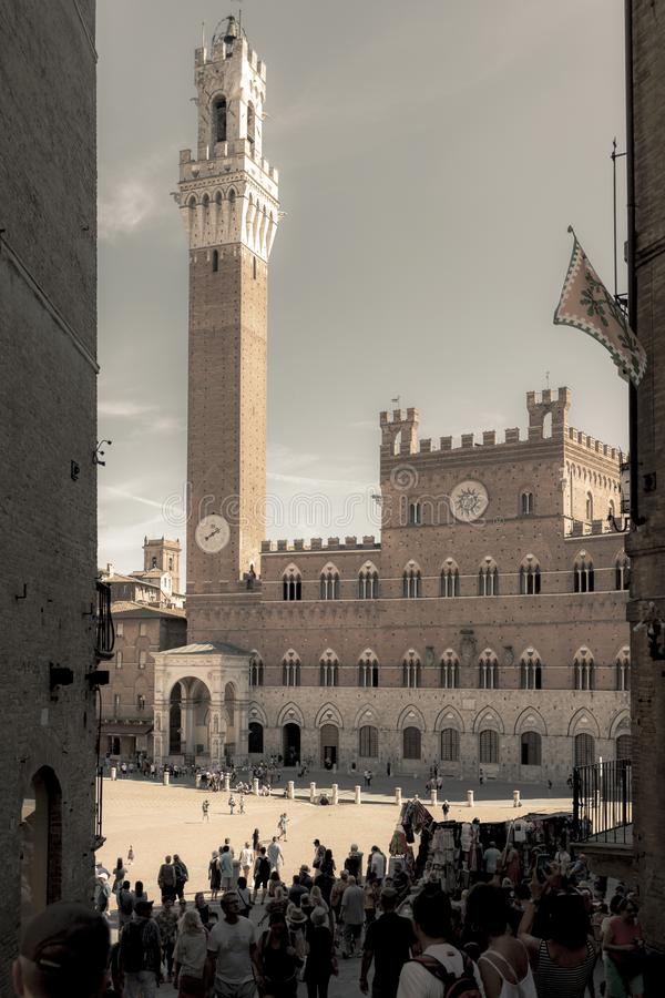 SIENA, ITALY - September 2019: Piazza del Campo in an antique version. SIENA, ITALY - SEPTEMBER 16: Tourists walk in Piazza del Campo, September 16, 2019 in royalty free stock photo