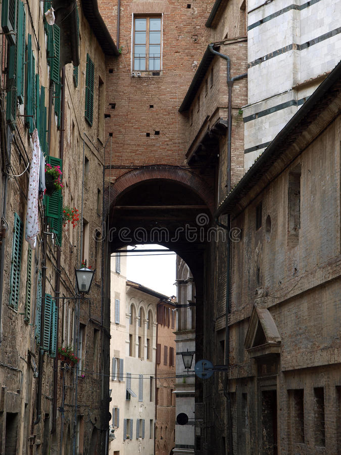 Siena. Picturesque street in the historic city centre stock images