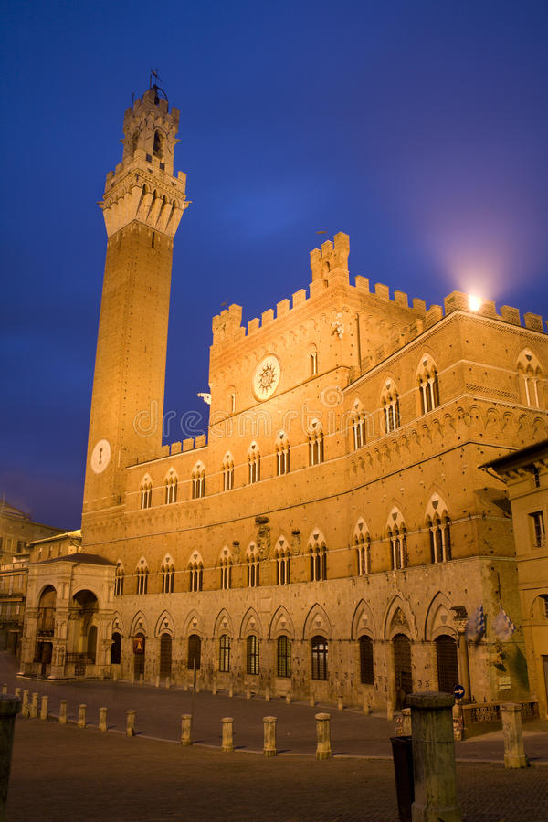 Siena - Town-hall and Torre del Mangia. In the nigh stock image