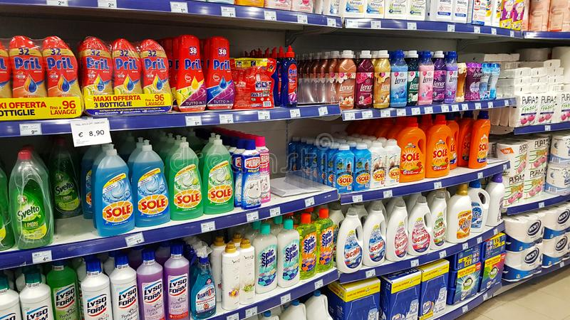 Supermarket shelves with cleaning products: detergents, disinfectants, soap, floor cleaners stock photo