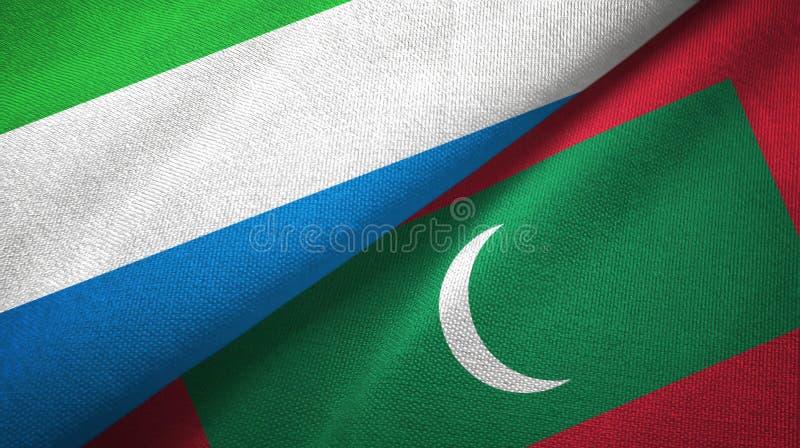 Sierra Leone i Maldives dwa flagi tekstylny p??tno, tkaniny tekstura obraz royalty free