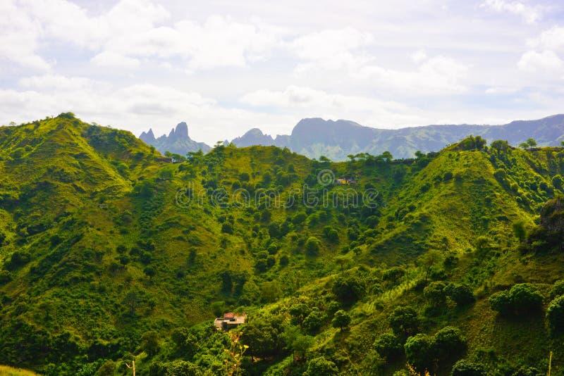 Sierra Malagueta Peaks, Cape Verde Volcanic Landscape, Santiago Island. Sierra Malagueta fertile mountain peaks and two small house farms on the slopes. Cape stock photography