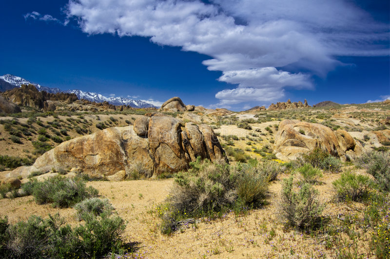 Sierra Wave over the Alabama Hills. The Sierra Wave drifting over the Alabama Hills. The Sierra Nevada Escarpment can be seen in the distance. Taken in April stock images