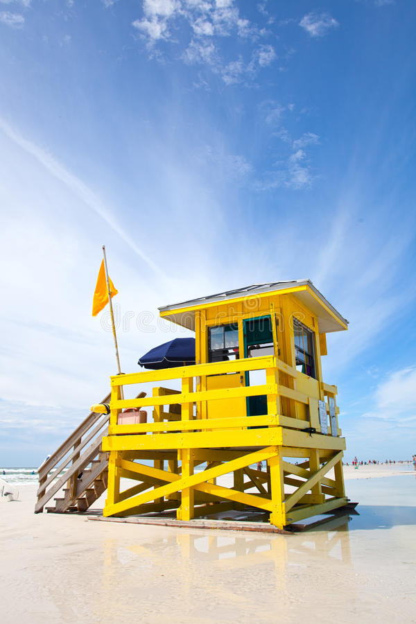 Siesta Key Beach, Florida USA, yellow colorful lifeguard house. On a beautiful summer day with ocean and blue cloudy sky royalty free stock photo