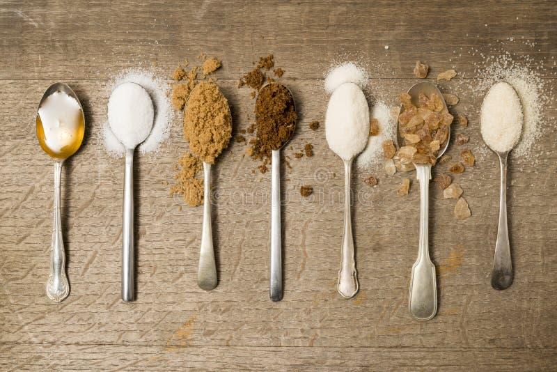 Siete cucharillas de azúcar al día foto de archivo libre de regalías