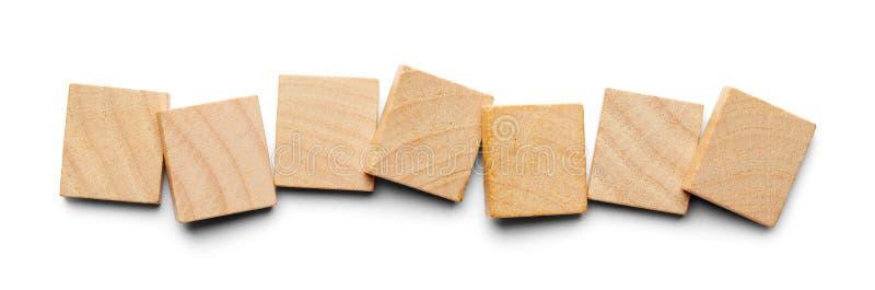 Siete tejas de madera imagenes de archivo