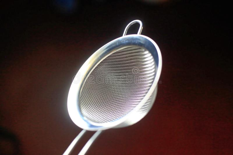 Sieve. Silver Sieve in a dark background royalty free stock images