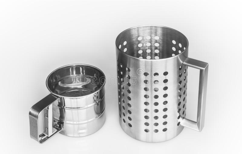 Kitchenwares. The sieves muge like; isolated stock images
