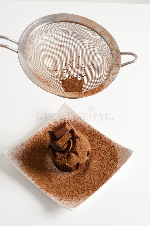 Download Sieving Coco Powder Onto Chocolate Muffin Stock Photo - Image: 12437102