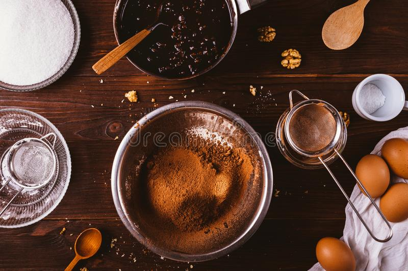 Sifted cocoa powder and flour in metal bowl royalty free stock photography