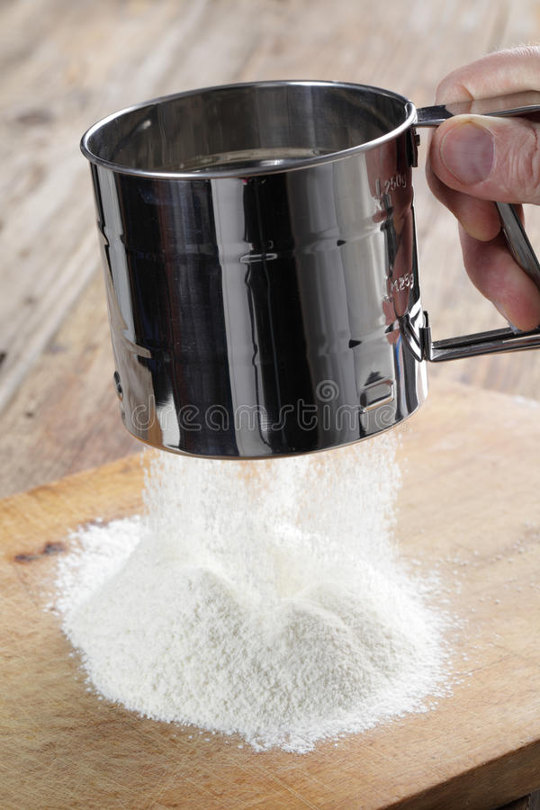 Sifting the flour royalty free stock photo