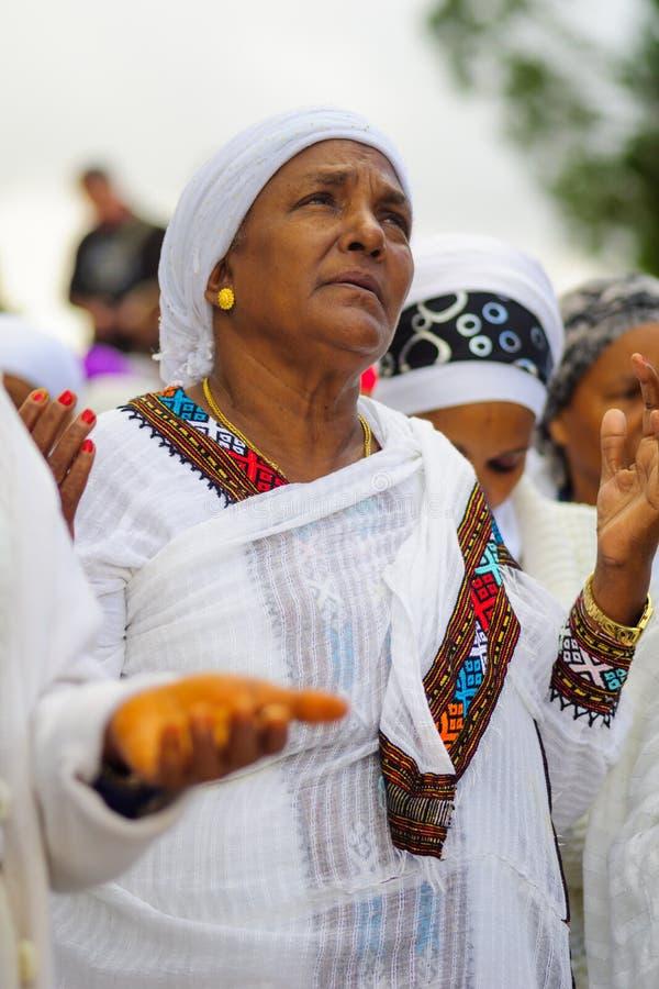 Sigd 2015 - holiday of the Ethiopian Jewry. JERUSALEM, ISRAEL - NOVEMBER 11, 2015: An Ethiopian Jewish woman pray at the Sigd, in Jerusalem, Israel. The Sigd is stock images