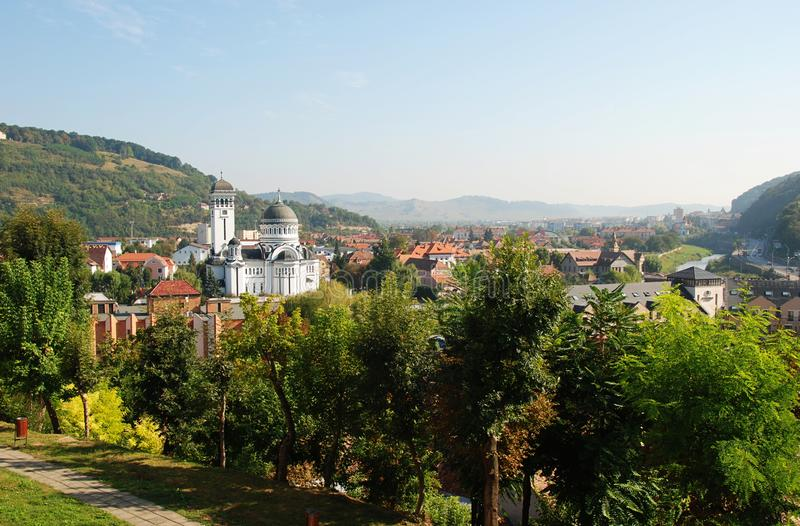 Sighisoara cityscape sorrounded by Carpathians royalty free stock photography