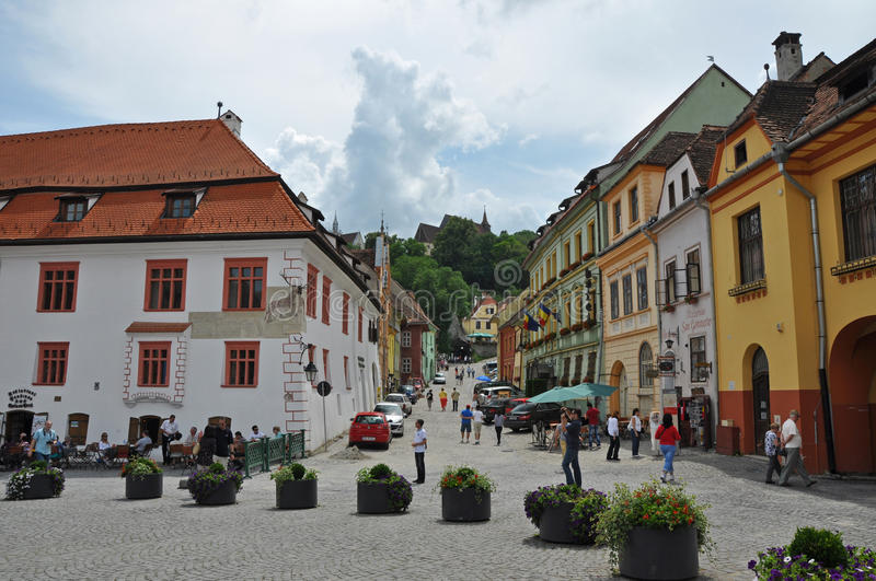 Sighisoara medieval city, Unesco heritage. SIGHISOARA, ROMANIA - JUNE, 28: Tourists visiting Sighisoara (Schassburg, Segesvar), the only inhabited medieval royalty free stock photo