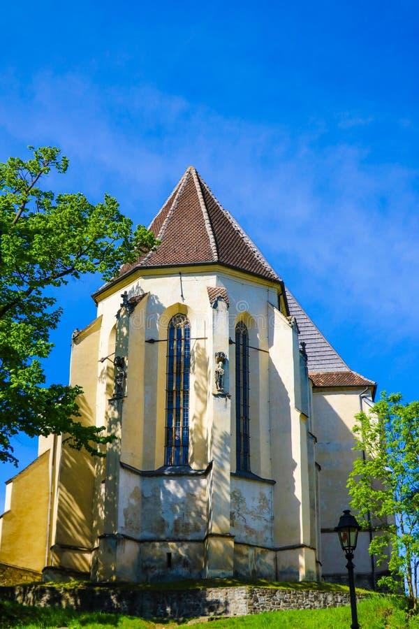 Sighisoara, Romênia, 12 de maio de 2019: Biserica din Deal é uma igreja luterana localizada em School Hill em Sighisoara Fundada  imagem de stock