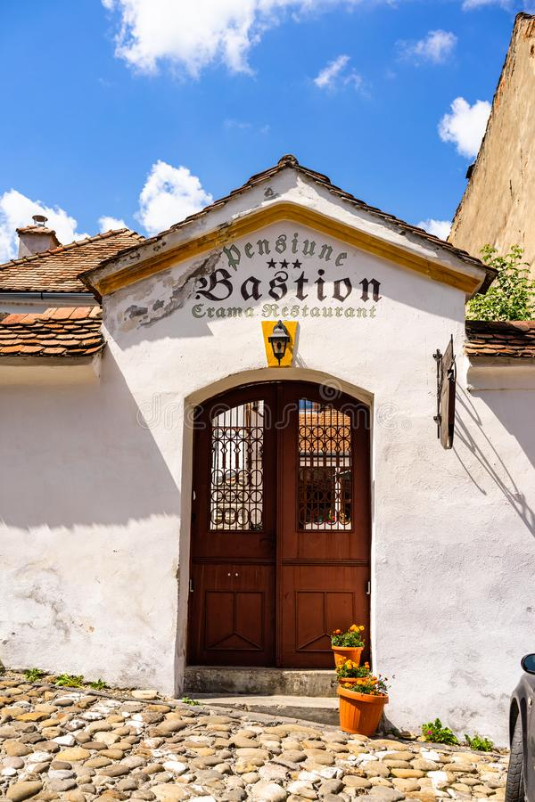 Sighisoara, Romania - 2019. Entrance of a restaurant on the street of Sighisoara old town royalty free stock photography