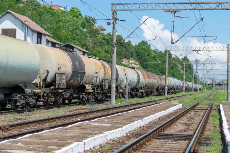 SIGHISOARA, ROMANIA - 1 JULY 2016: Cargo wagons at the Sighisoara train station in Romania stock image