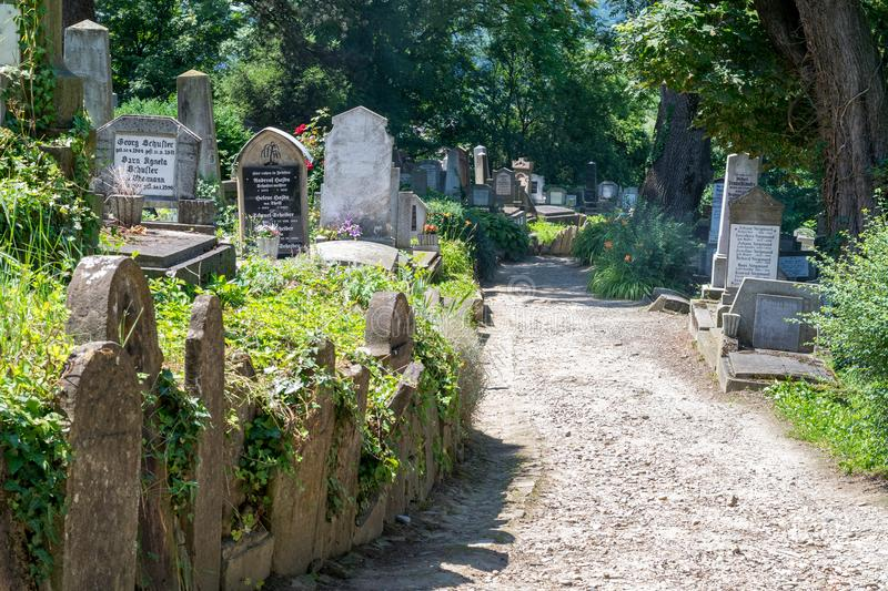 SIGHISOARA, ROMANIA - 1 JULY 2016: Saxon cemetery, located next to the Church on the Hill in Sighisoara, Romania stock image