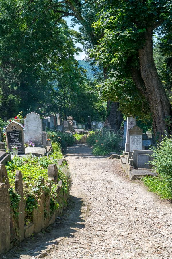SIGHISOARA, ROMANIA - 1 JULY 2016: Saxon cemetery, located next to the Church on the Hill in Sighisoara, Romania stock photography