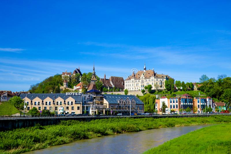 Sighisoara, Romania, May 11, 2019: Panoramic view over the cityscape and roof architecture in Sighisoara, medieval town of royalty free stock photography