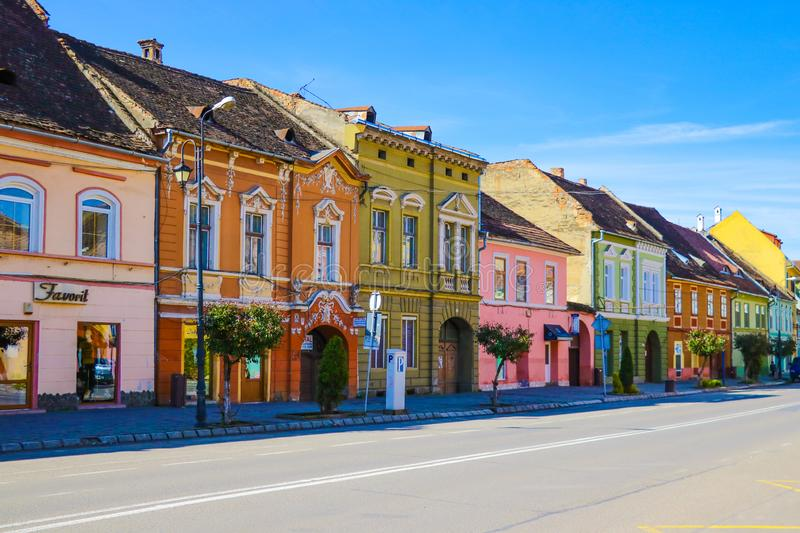 Sighisoara, Romania, May 11, 2019: Stone paved old street and cafe bar with colorful retro buildings in city center, Sighisoara stock photo