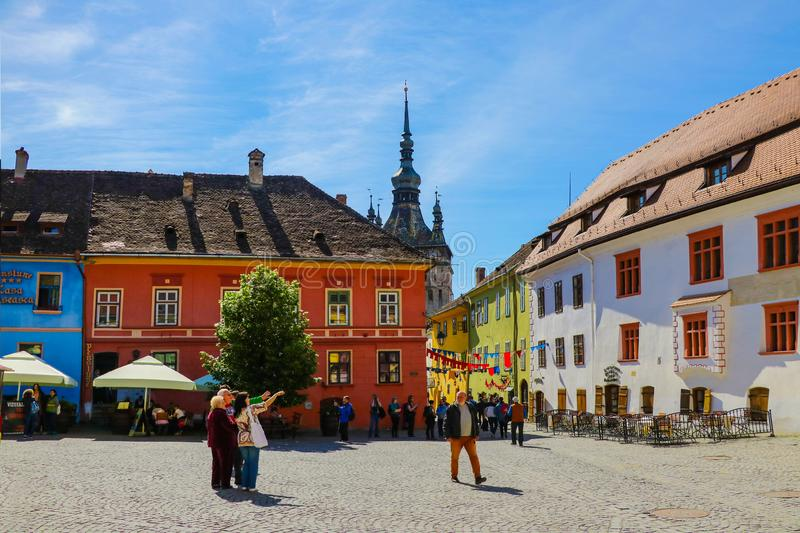 Sighisoara, Romania, May 12, 2019: Stone paved street with colorful houses in the medieval city of Sighisoara. Amazing medieval stock photo
