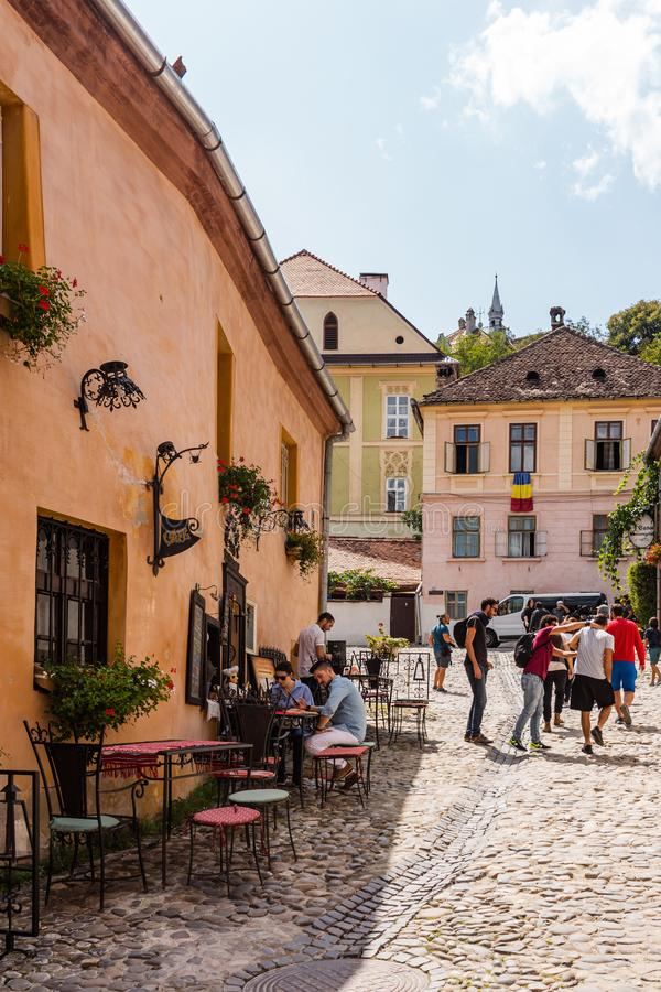Sighisoara, Romania - 2019. People having lunch and wandering on the streets of Sighisoara old town stock images