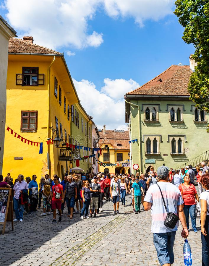 Sighisoara, Romania - 2019. People wandering on the streets of Sighisoara citadel old town. Streets with colorful houses stock images