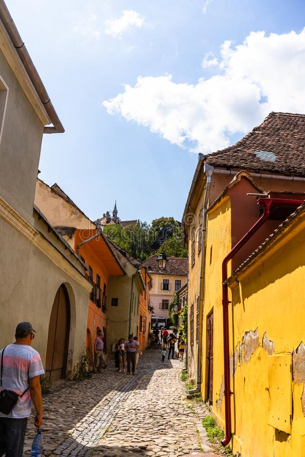 Sighisoara, Romania - 2019. People wandering on the streets of Sighisoara citadel old town. Streets with colorful houses royalty free stock photos