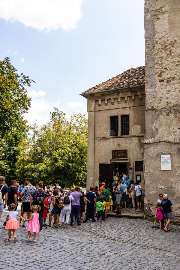 Sighisoara, Romania - 2019. Tourists waiting in line to visit the History Museum in Sighisoara citadel stock photos