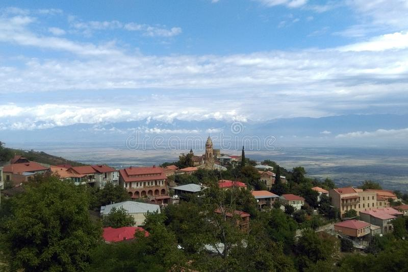 Sighnaghi city of love in Georgia, Kakheti region. Red roofs of houses and brick towers of the cathedral and fortress royalty free stock photography