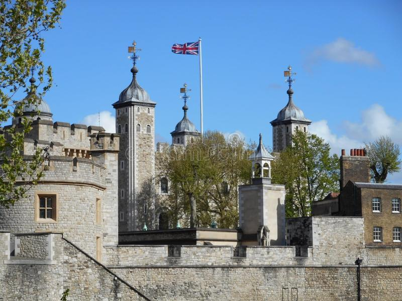 London tower with flag waving royalty free stock images