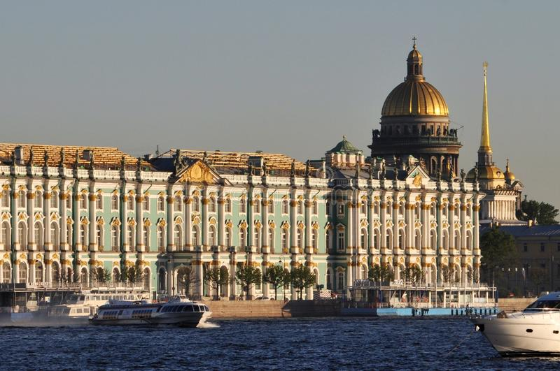Sights in Saint Petersburg. Summer sights of Saint Petersburg on the shore of Neva River include the State Hermitage museum, the dome of St Isaac Cathedral, the royalty free stock image