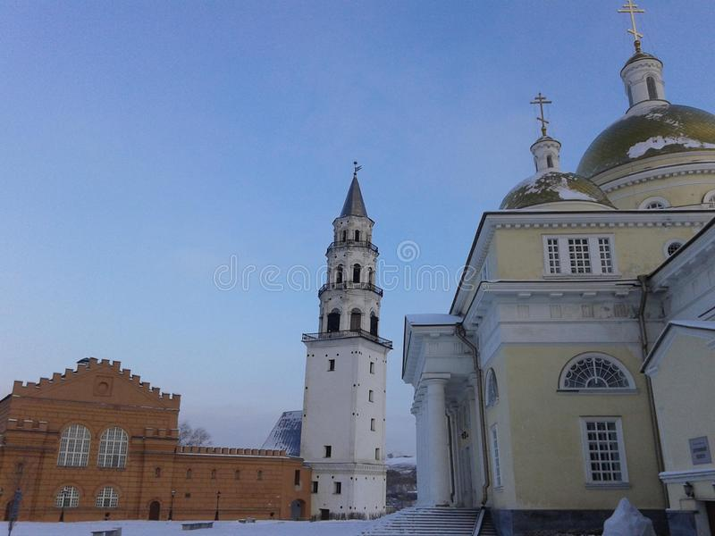 Sights of the Ural city of Nevyansk, Sverdlovsk region. In the background you can see the famous leaning tower Demidov.  stock photography
