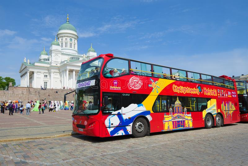 Sightseeing bus of the Hop On Hop Off system on the Senate Square on a sunny June day. Helsinki, Finland. HELSINKI, FINLAND - JUNE 11, 2017: Sightseeing bus of stock photos