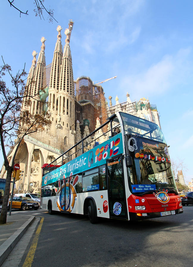 Free Sightseeing Bus In Front Of Sagrada Familia Royalty Free Stock Image - 27811926