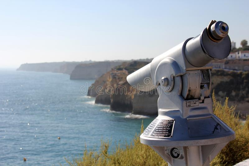 Sightseeing coin operated telescope. On the cliffs used for looking out into the sea in Carvoeiro, Algarve, Portugal. Wording on the telescope is instructions royalty free stock image