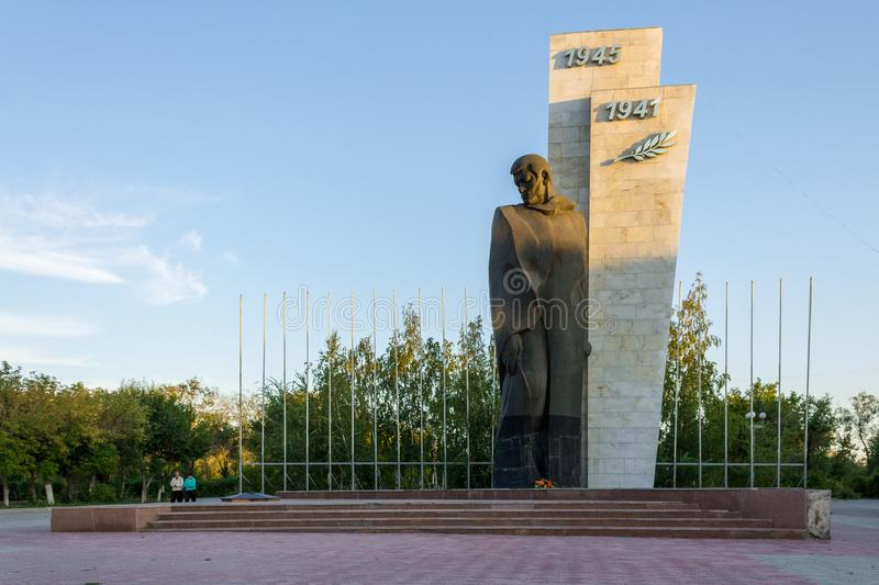 Panorama view on lonely Monument of the unknown soldier second world war. The Person is standing. Located in Temirtau, Kazakhstan stock photo