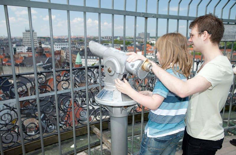 Sightseeing lookout binoculars copenhagen child tourist. Sightseeing lookout binoculars with view of copenhagen. child tourist use telescope to see capital of stock photo