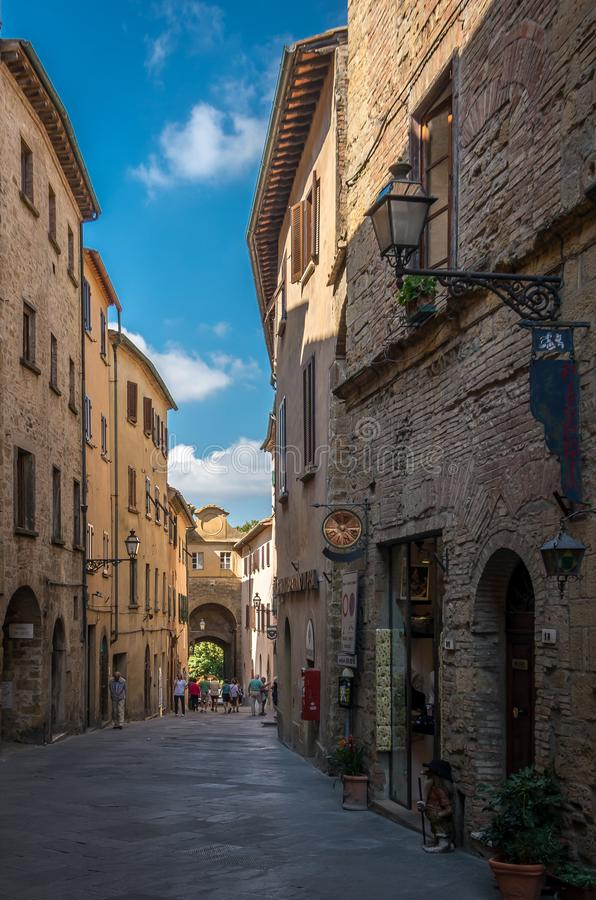 Sightseeing narrow alleyway in the old city center of Voltera, Italy. Sightseeing historical narrow alleyway in the old city center of Voltera, Italy stock photography