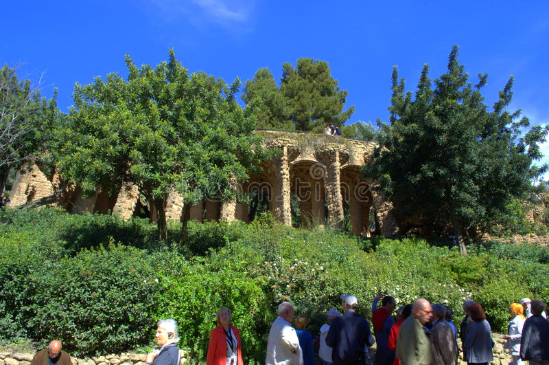 Sightseeing in Park Guell,Barcelona. Tourist grpoup sightseeing in picturesque Park Guell,The Park Güell is a public park system composed of gardens and stock image