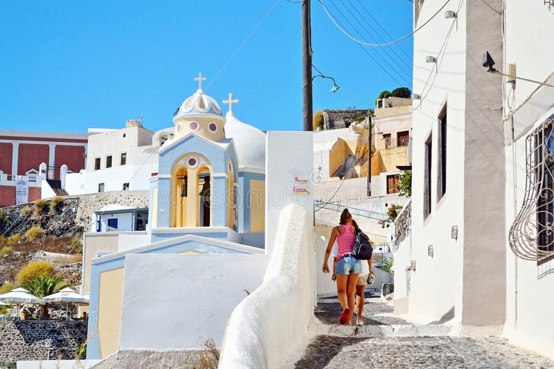 Tourist women discover Santorini island Greece royalty free stock photography