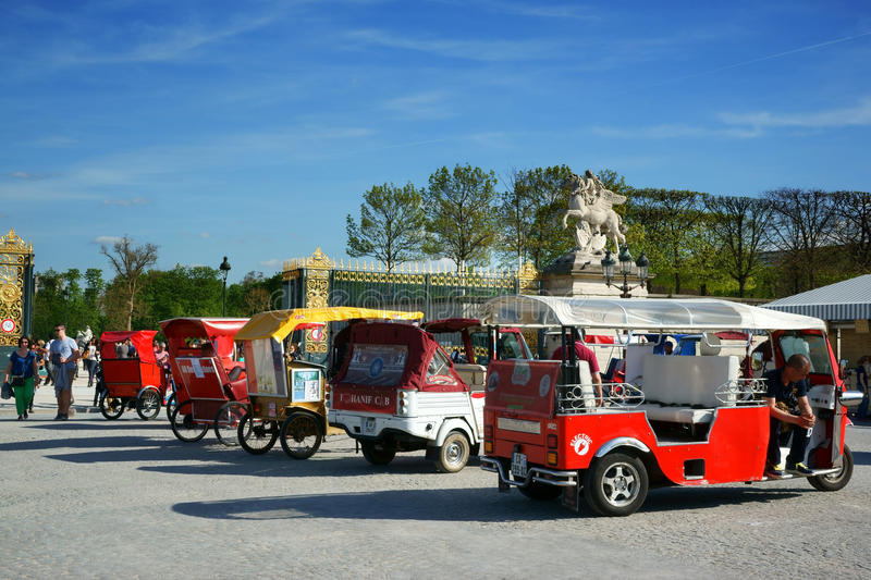 Sightseeing by Tuk-Tuk, Paris. Several Tuk-Tuks parked in a row. April 13, 2015 - In front of the Tuileries Garden, Paris, France stock photos