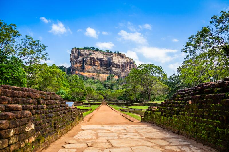 Sigiriya or Lion rock - ancient rock fortress with brick wall in the foreground, Dambulla, Central Province ,Sri Lanka stock photos