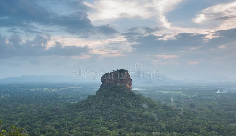 Sigiriya Lion Rock fortress, view from Pidurangala,Sri Lanka. Consider as the 8th wonder of the world royalty free stock image