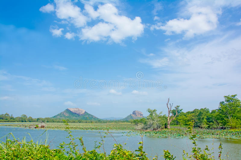 Sigiriya Rock Fortress View From Thalkote Lake. Spending the evening time around Thalkote lake is a popular way among the tourists stock image