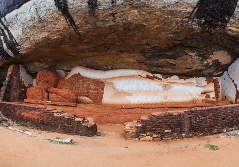 Sigiriya, Sri Lanka - April 29 2018: Ruined buddha statue on pidurangala mountain royalty free stock photography