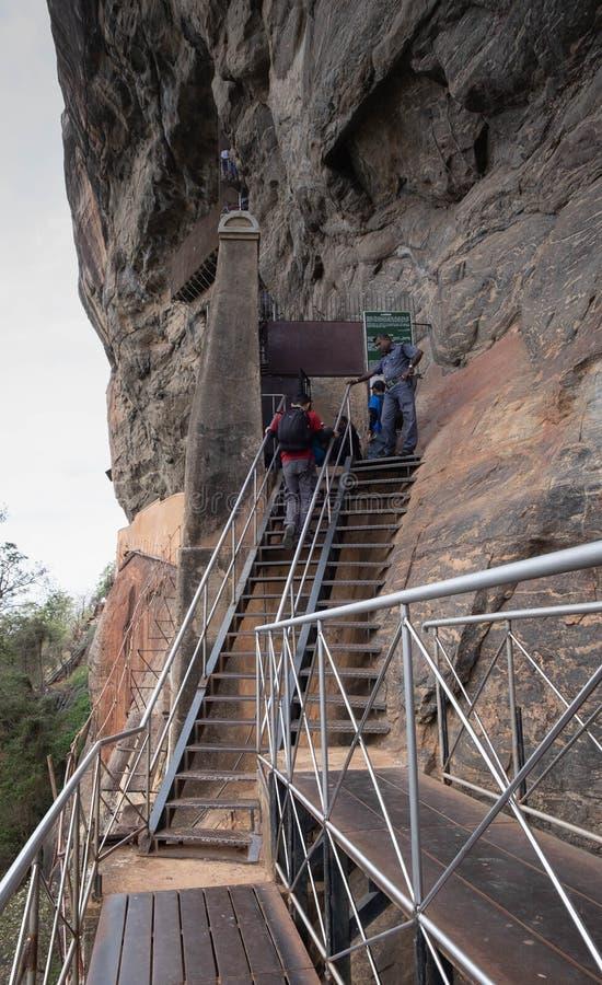 Tourists walk along a trail climbing to Sigiriya Rock Fortress. Sri Lanka stock image