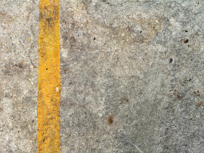 sign on street, old yellow line on dark concrete floor. royalty free stock photos